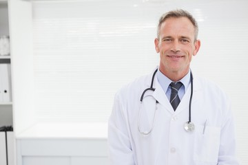 Smiling doctor looking at camera