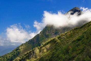 Mountain peak hidden cloud.