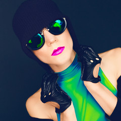 bright glamorous lady on black background in trendy sunglasses a