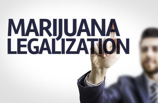 Business man pointing the text: Marijuana Legalization