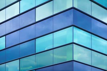 Modern office facade fragment with blue green glass