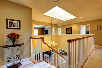 Luxury house interior. Upstairs hallway with staircase