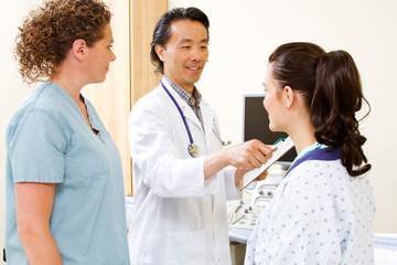 Radiologist preparing patient for CAT scan