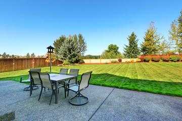 Patio area overlooking backyard landscape