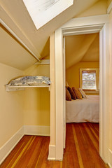 Small empty walk in closet interior