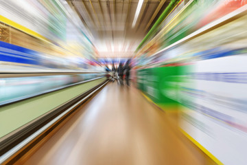 Wide perspective of empty supermarket aisle