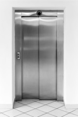Modern office fragment, shining metal elevator doors