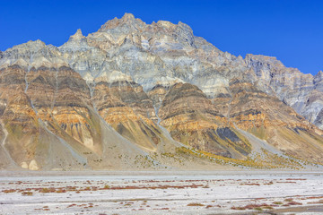 High layered eroded hill in Spiti valley, India