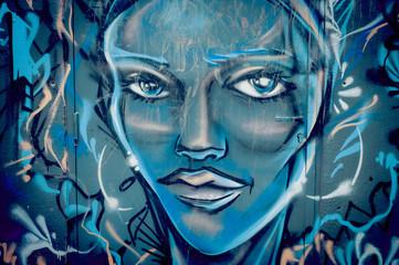 Graffiti visage de femme bleu