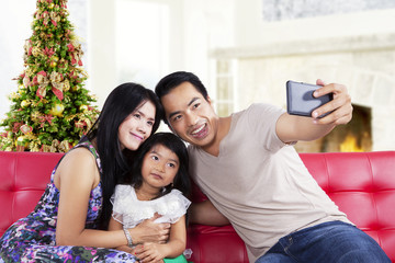 Family take a self photo together