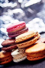 Stack of macaroons with silver background
