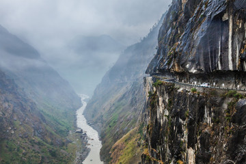 Car on road in Himalayas Wall mural