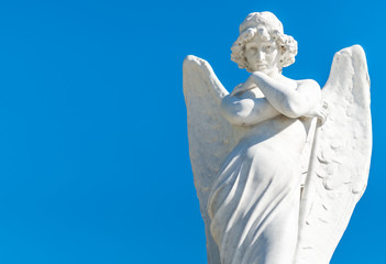 Beautiful young female angel on a blue sky background