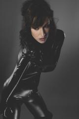 sexy woman dressed in black latex, future concept and new techno