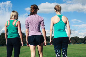 Three women wearing sportswear in the park