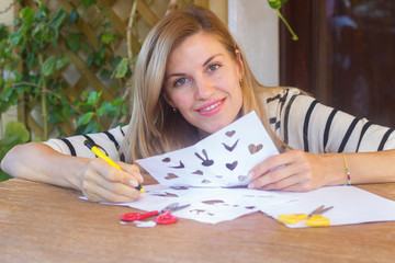 Girl making typical greetings letter for Danish Easter