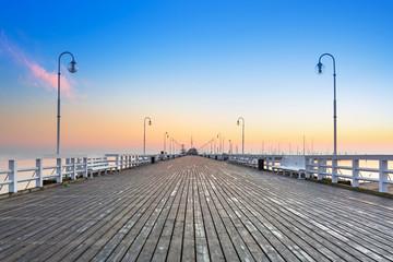 Fotobehang Meloen Sunrise at wooden pier in Sopot over Baltic sea, Poland