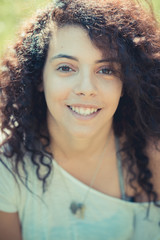 young beautiful moroccan curly woman