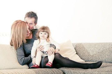 Mother, father and daughter on Sofa