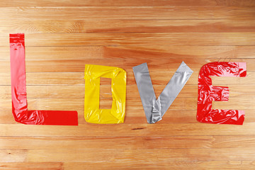 Love word formed with colorful scotch strips