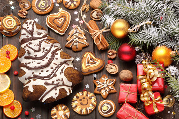 Christmas decoration with cake in the shape of Christmas tree an
