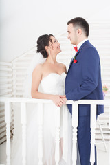 Bride and groom on a white background
