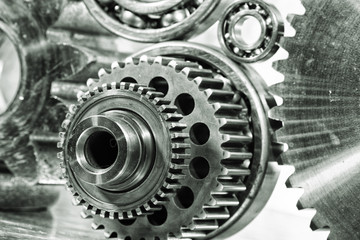 cogwheels, gears and machinery against titanium