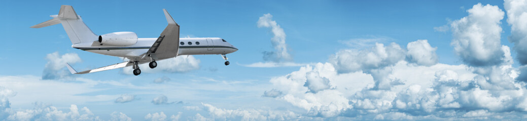 Wall Mural - Private jet is maneuvering for landing