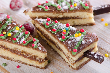 Christmas tree made of  cake on  a wooden background .