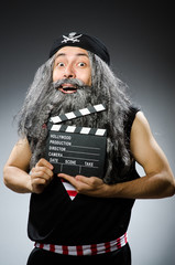 Old pirate with movie board
