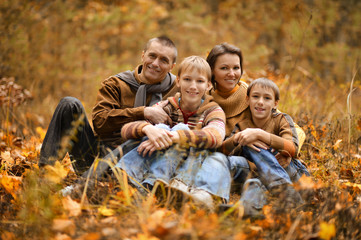 Family of four in autumn