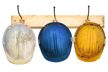 Three helmets hanging on a hat-rack