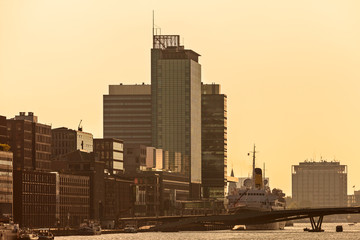 Sunset view of Amsterdam with modern buildings