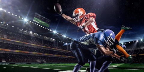 American football player in action at game time Wall mural