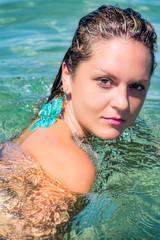 Beautiful Woman Relaxing in turquoise Water
