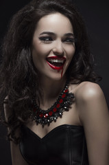 Portrait of a pale gothic vampire woman
