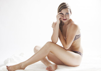 Blonde woman wearing lingerie and sitting