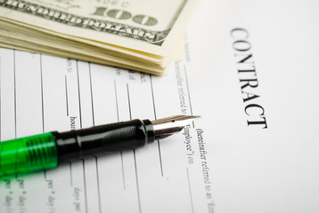 Pen on the contract papers and us dollars