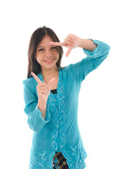 Pretty female Asian model smiling in traditional kebaya tress