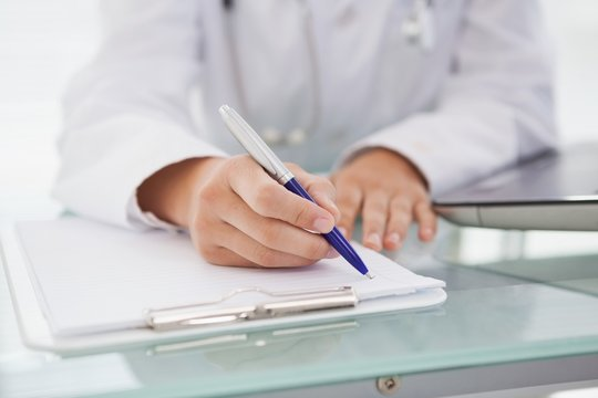 Doctor writing down medical notes