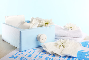 Sanitary pads in box and sanitary pads and white flowers