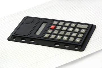 Taschenrechner auf Papier