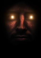 Scary demonic face with burning eyes