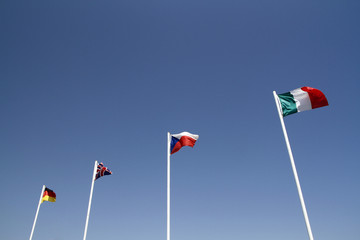 four flags waving in wind
