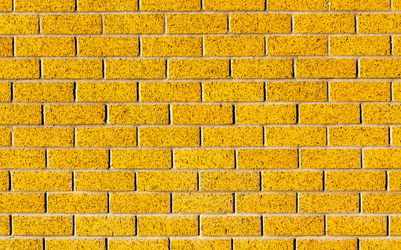 Energetic yellow brick wall as a background image with black vig