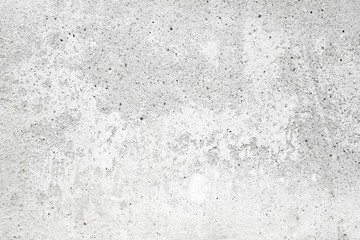 White concrete wall with stucco and paint, background texture