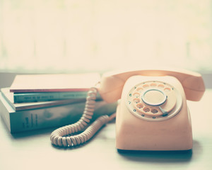 Vintage pink telephone over a table
