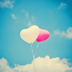 Heart shaped balloons in flight