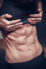 Woman posing with perfect abdomen muscles