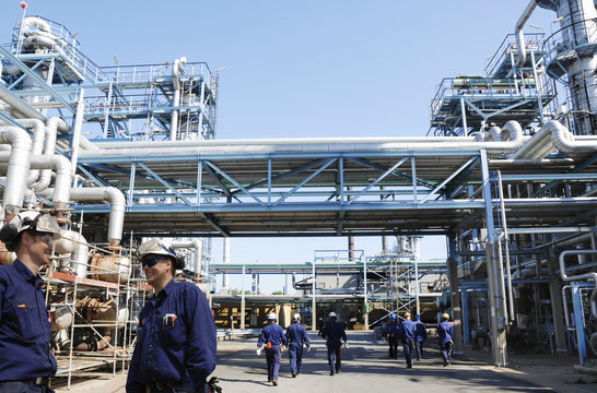 refinery workers in action, as seen inside the industry